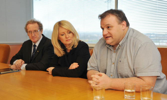 Lindsay Roy MP and Esther McVey Works and Pensions Secretary with Remploy shop steward Colin Cuthbert.