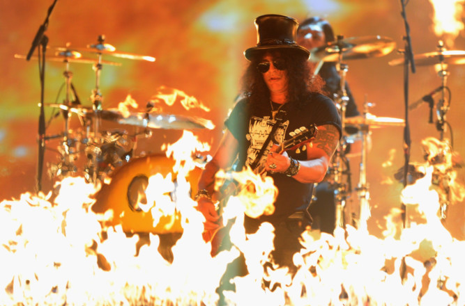 Some of the biggest stars of the music world flocked to Scotland for the MTV music awards at the Glasgow Hydro. Slash performs on stage.