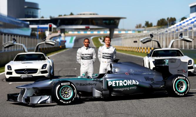 Lewis Hamilton and Nico Rosberg with this season's Mercedes car.