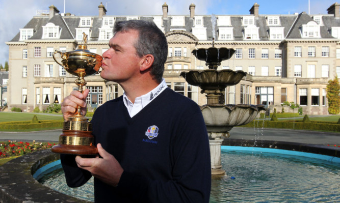 A kiss for good luck  Scottish golfer Paul Lawrie with the Ryder Cup at Gleneagles.