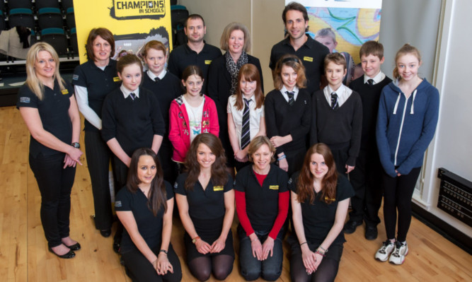 Sports Minister Shona Robison with pupils from Perth Grammar School and St Johns Academy and local sports stars, including adventurer Mark Beaumont.
