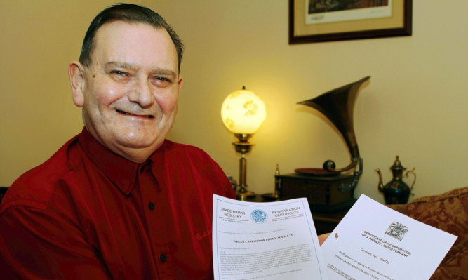 Ed Sweeney with paperwork showing his rights to the famous name.