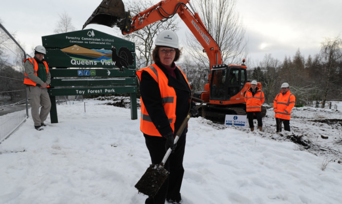 Councillor Kate Howie breaks the ground in the first phase of the refurbishment.