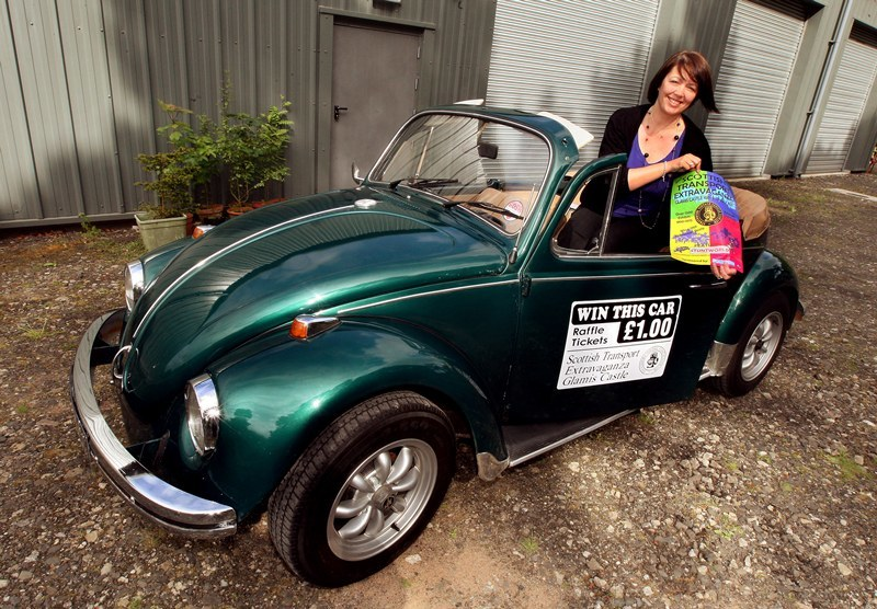 John Stevenson, Courier,02/06/10.Angus,Glamis,Pic shows the first prize raffle car a 1969 VW Beetle Convertible which can be won at the  Scottish Transport Extravaganza at Glamis Castle.Pic shows Lesley Munro from the Strathmore Vintage Vehicle Club with the vehicle.