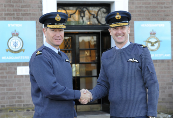 Air Commodore Gavin Parker (left) hands over to the RAF Leuchars new Station Commander and Air Officer Scotland Air Commodore Gerry Mayhew.