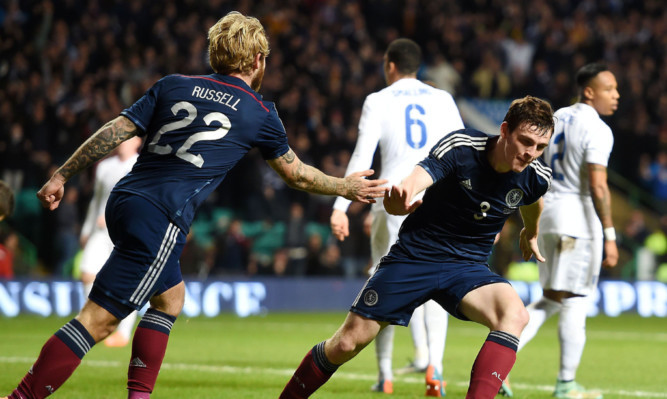 A goal made in Tannadice: Andrew Robertson wheels away after scoring Scotland's goal against England.
