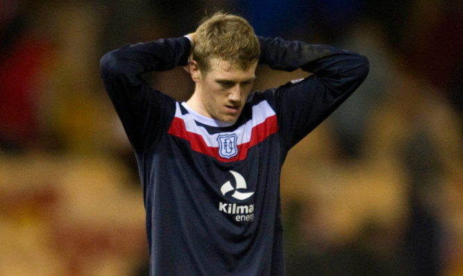 A dejected Jim McAlister at the final whistle.