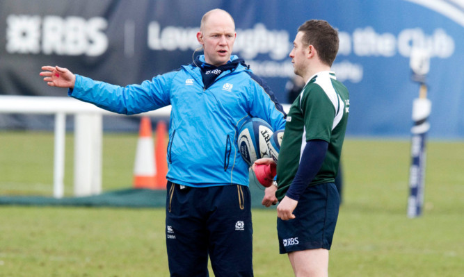 Scotland coach Duncan Hodge (left) chats to Greig Laidlaw.