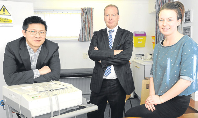 Dr Ronnie Ip, practice manager Jim Devine and receptionist Lucy Anderson.
