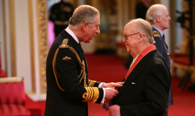 Gordon Baxter receives his CBE from the Prince of Wales at Buckingham Palace in 2010.