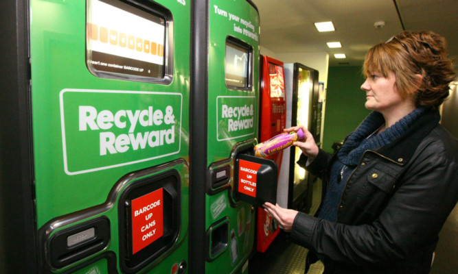 Student Debbie Morrison using one of the 'Recycle & Reward' machines.