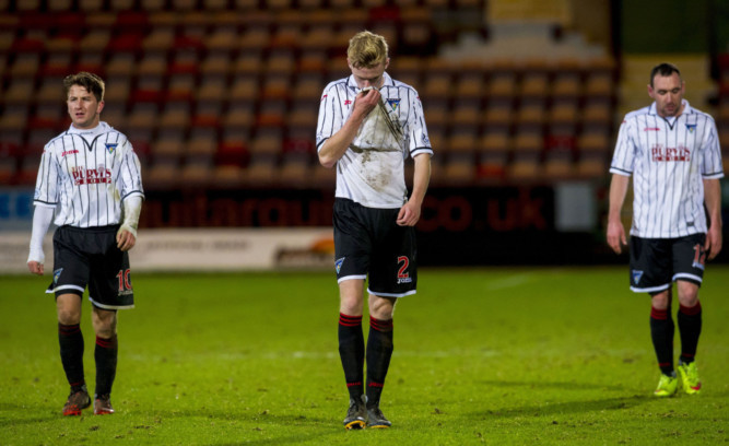 Dejection for Dunfermline's Josh Falkingham, Ross Millen and Michael Moffat as their side crashes out of the Scottish Cup