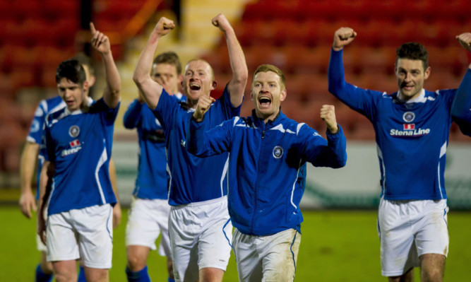 Stranraer celebrate at full time having beaten Dunfermline to progress to the next round of the cup
