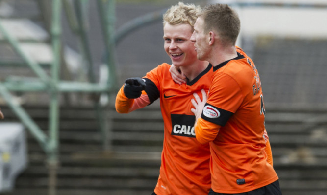 Gary Mackay-Steven celebrates his goal with team-mate Michael Gardyne.