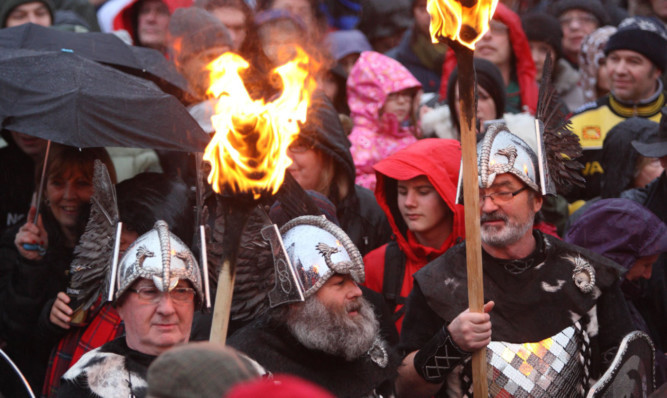 Up Helly Aa members mix with the crowds in Pitlochry.
