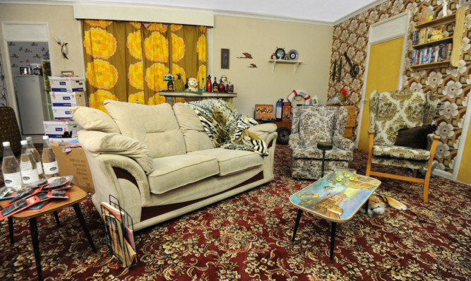 A recreation of the Trotters' living room before the makeover.