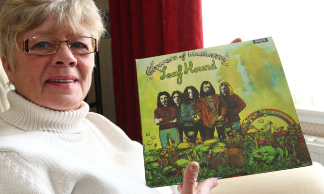 Lynn Grant with husband Roys album, which has attracted bids of more than £1,400.