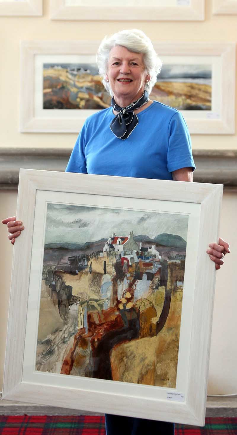 Steve MacDougall, Courier, Duchess Anne Hall, Dunkeld.  40th Dunkeld Cathedral Art Exhibition. Pictured, exhibition chairman Sonja Arbuthnott holdind a piece by artist Liz Myhill entitled 'Corroding Sheep Fanks', with other work by the artist in the background. Liz Myhill is one of the main invited artists along with Peter McDermott. Liz Myhill graduated from Duncan of Jordanstone in 2004.