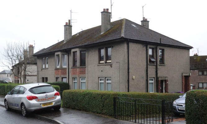 The property on North Bank Street, Monifieth, where Heather Mair died after her sofa caught light.
