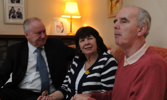 Amanda Kopel with her husband Frank, right, when former Health Secretary Alex Neil visited the couples Kirriemuir home in March last year.