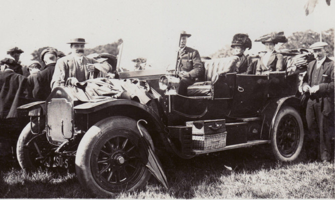 One of the old photos showing the number plate's long history. (Click right arrow for more.)