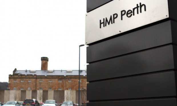 Kris Miller, Courier, 20/02/13. Picture today shows sign for HMP Perth with Perth Prison in background for file.