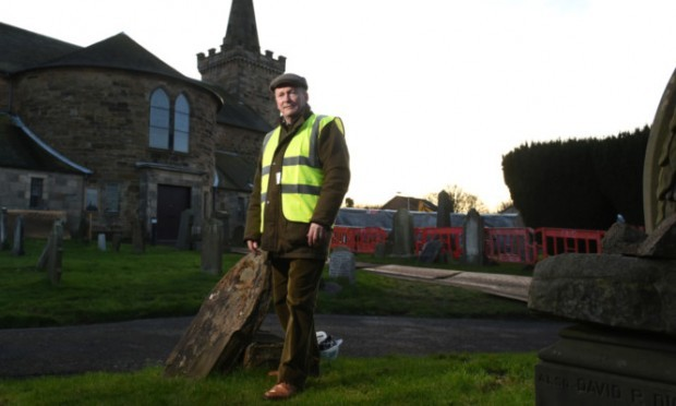 Exhumer Peter Mitchell in the grounds of the Abbotshall Church.