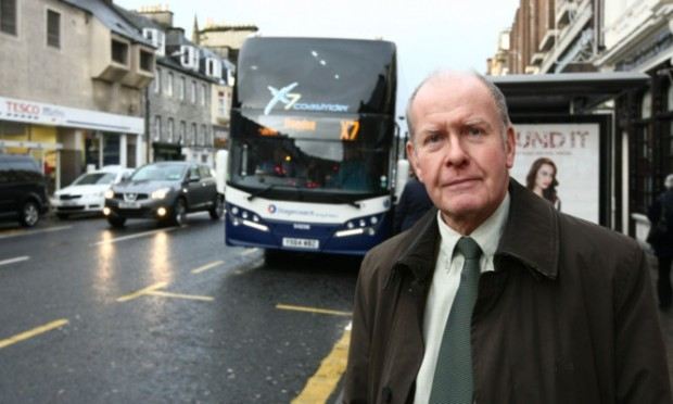 Cllr Willie Wilson with the X7 bus behind him.