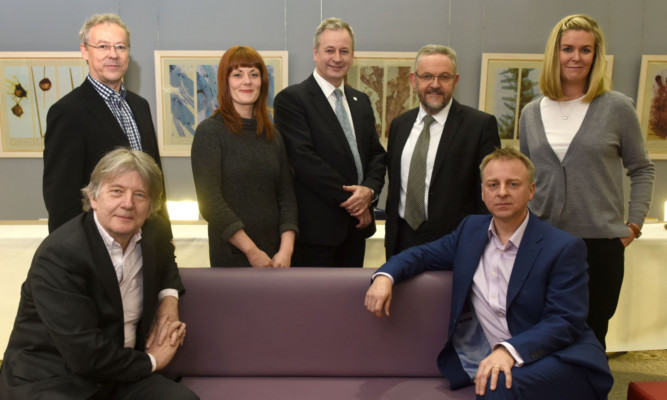 Dundee University held a public event to mark the citys status as a Unesco City of Design. The panel was (back from left) Brian Beattie, Gillian Easson, David Martin, Stewart Murdoch and Laura Aalto. Front: Deyan Sudjic and Philip Long.