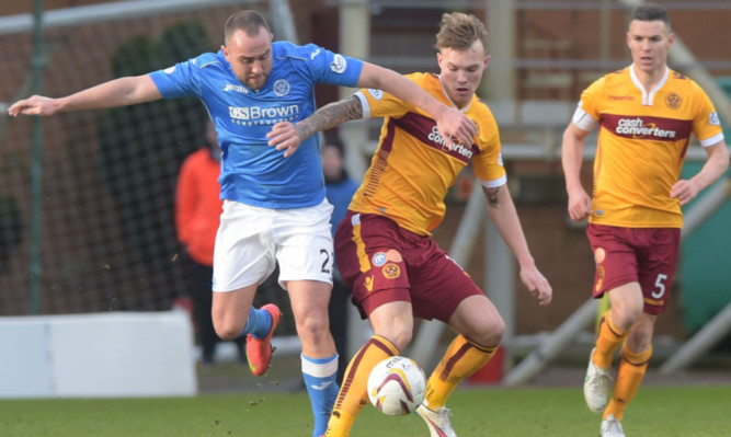 Lee Croft battles for possession with Lee Erwin.