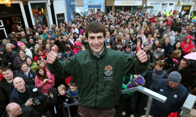 Ryan Mania is given a heros welcome in his home town of Galashiels as hundreds turned out to see the Grand National winning jockey.