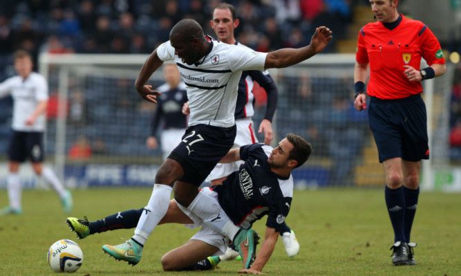 Christian Nade and Tom Taiwo compete for the ball.
