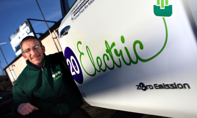 Driver Duncan Menzies with one of the 203020 electric taxis.