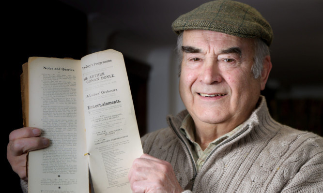 Walter Elliot with his book containing a short Sherlock Holmes story by Sir Arthur Conan Doyle.