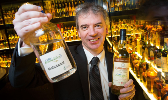 Martin Tangney with bio-butanol, made from the by-products of whisky fermentation.