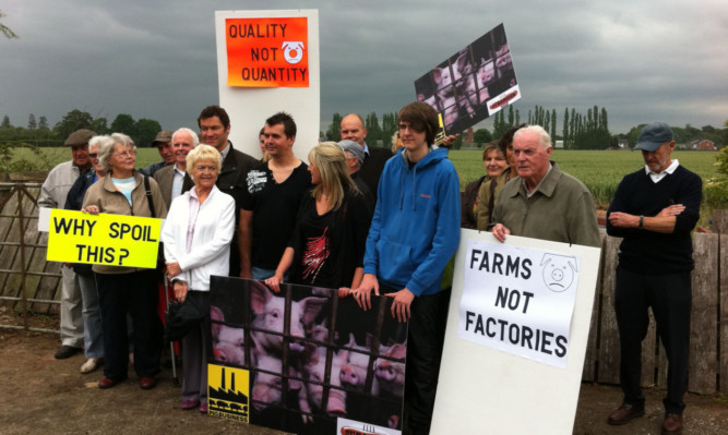 Actor Dominic West, behind woman in white jacket, with some of the people who protested against the proposal.