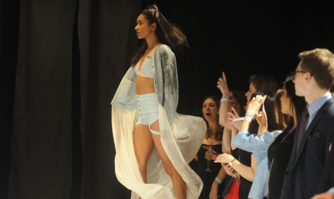 Action from the annual Dont Walk charity fashion show, this year held in a converted barn.