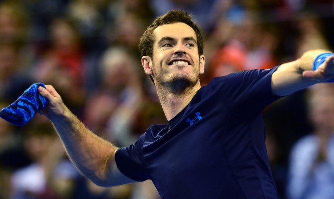 Andy Murray reacts after beating John Isner.