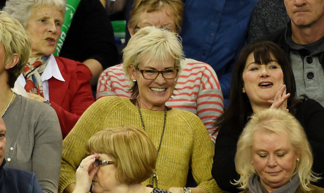 Judy Murray (centre) watching son Andy seal the winning match against the USA at the weekend.