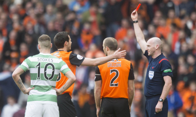 Sean Dillon is shown a red card.