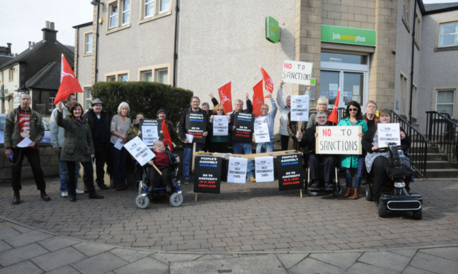 Tam Kirkby, centre, with the campaigners in Kirkcaldy.