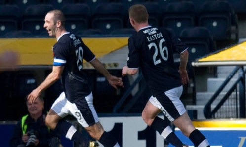 Gary Harkins (left) wheels away to celebrate putting Dundee in front again with his second goal of the game against Kilmarnock.