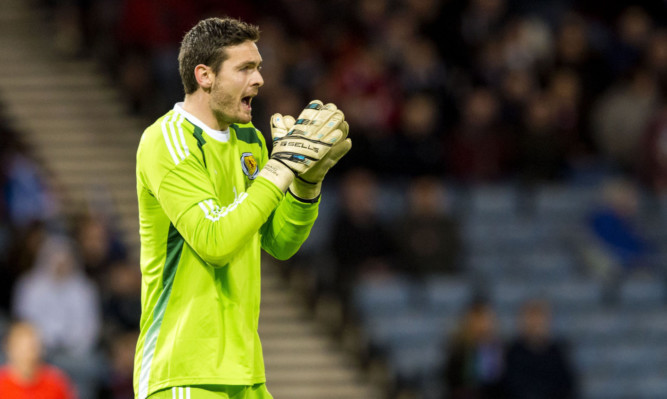 Craig Gordon in action for Scotland.
