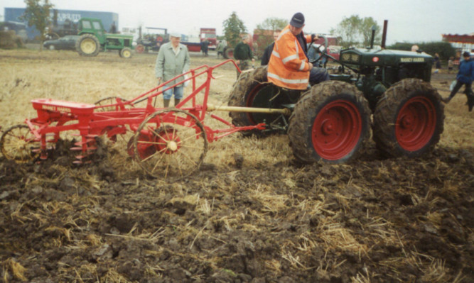 A rubber-tired example with an MH Pulverator plough at a working event in Lincolnshire.