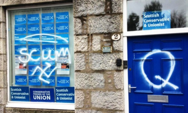 """The Conservative and Unionist Association office in West Mount Street, Aberdeen which was vandalised with the word """"scum"""", a swastika and the letter """"Q"""" in white spray paint."""