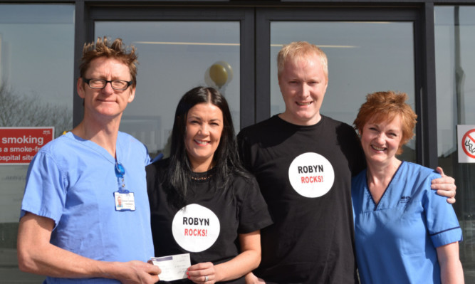 Dr Graham Tydeman, Alison and Rob Askew, and fetal medicine midwife Isobel Clegg.
