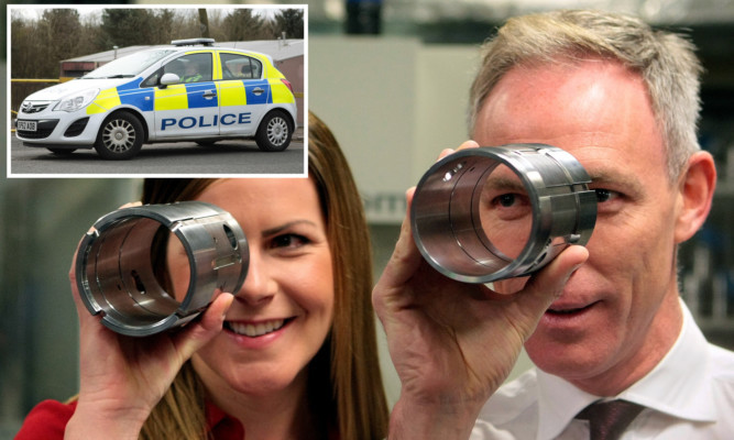 Jim Murphy and Labour candidate Melanie Ward at Fife Fabrications while (inset) police waited outside.