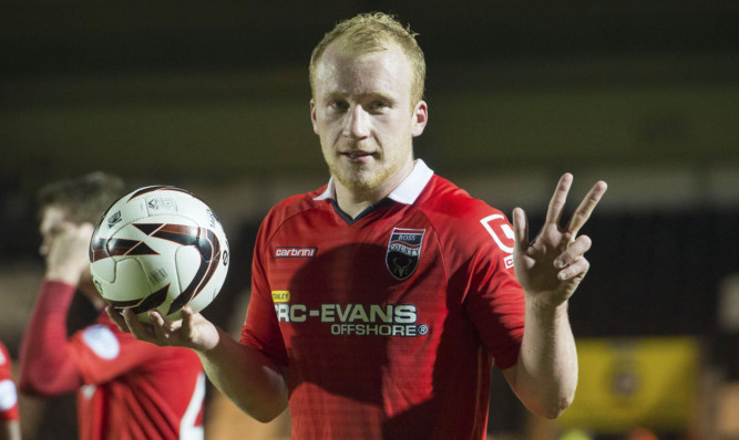 Liam Boyce collects the match ball.