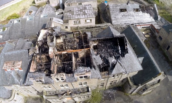 A still from drone footage showing the roof damaged by Monday's fire.