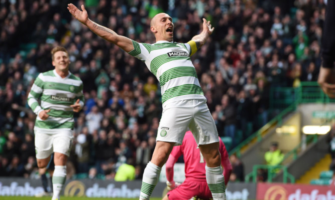 Scott Brown celebrates after making it 2-0 to Celtic.